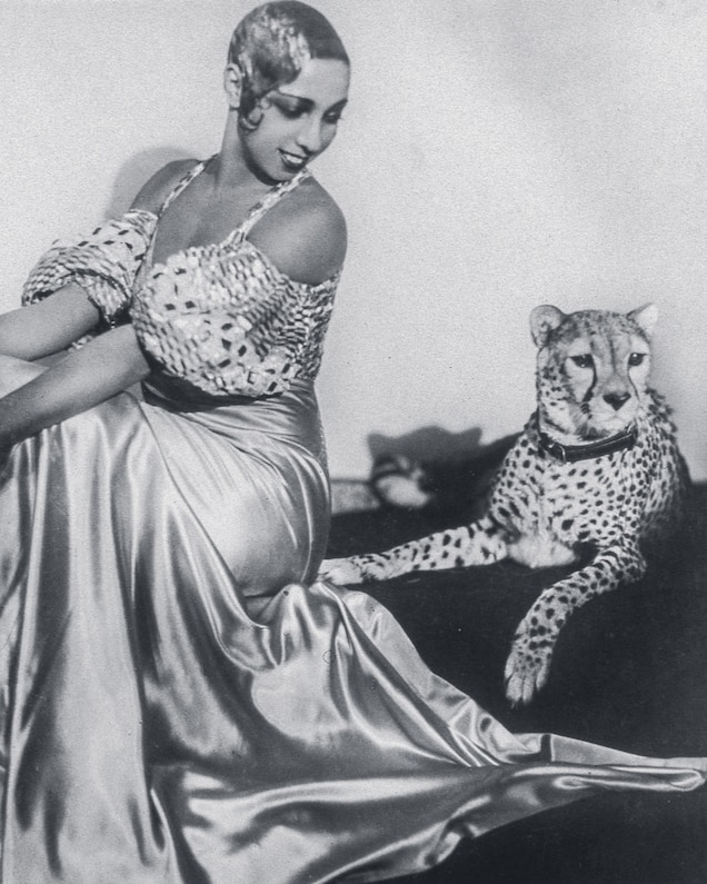 Cabaret star Josephine Baker poses with her cheetah, Chiquita, in the 1930s. A gift from a club owner, Chiquita became part of Baker's act and later traveled with her.