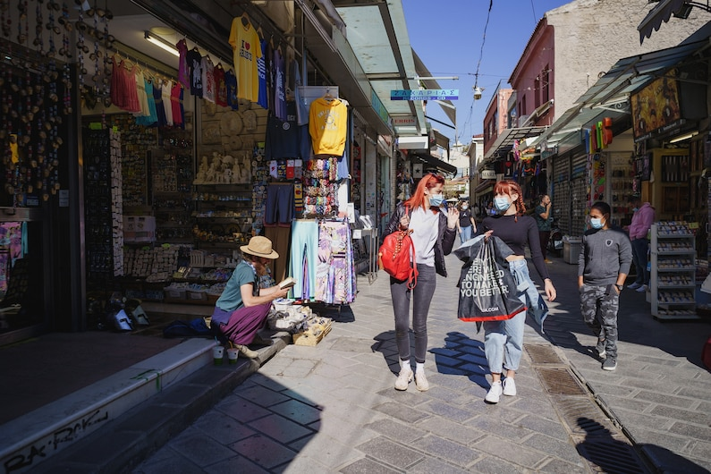 people walking through the tourist district in Athens, Greece