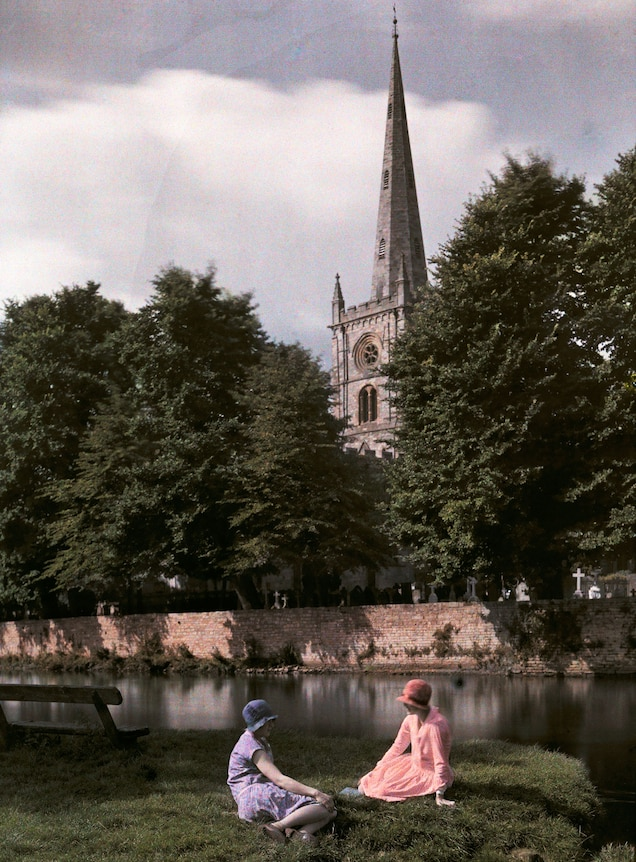 <p>Women sit by the banks of the Avon River in Stratford, England.</p>