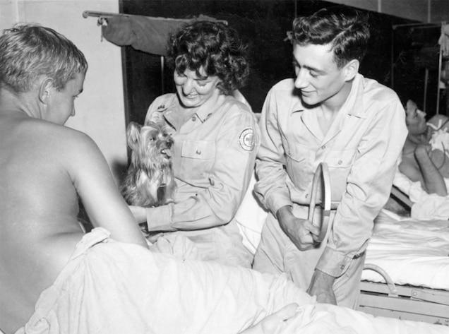 Bill Wynne holding Smoky the dog.