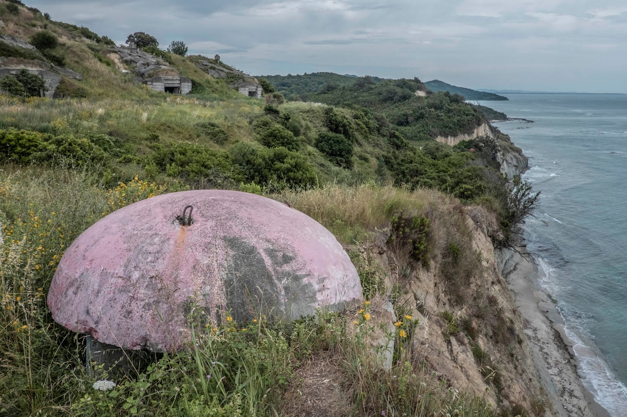 a group of abandoned bunkers near the beach in the peninsula of Cap Rodon