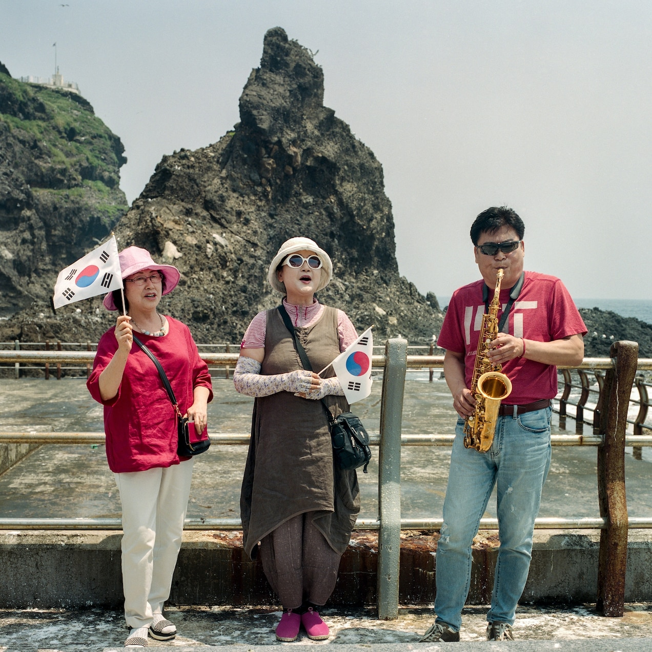 Dokdo tourists serenade the landscape with patriotic songs.