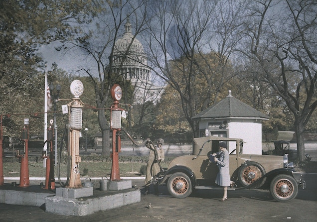 """<p>A woman looks on as her car is gassed up in <a href=""""https://www.nationalgeographic.com/travel/destination/washington-dc"""" target=""""_blank"""">Washington, D.C.</a>, in the 1920s. While white women might turn to personal automobiles as an alternative to restrictive regulations on public transport, black women had to rely on the 1936 """"Green Book"""" to indicate where it was safe to stop and refuel in the Jim Crow South.</p>"""