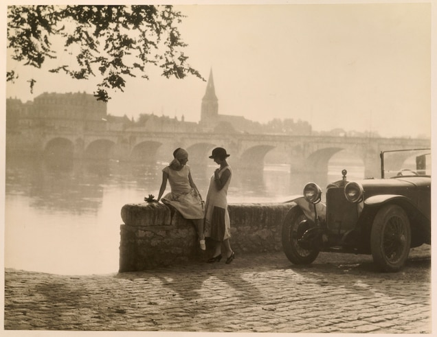 """<p>Women talk along the banks of the Loire River in Saumur, <a href=""""https://www.nationalgeographic.com/travel/destination/france"""" target=""""_blank"""">France</a>.</p>"""