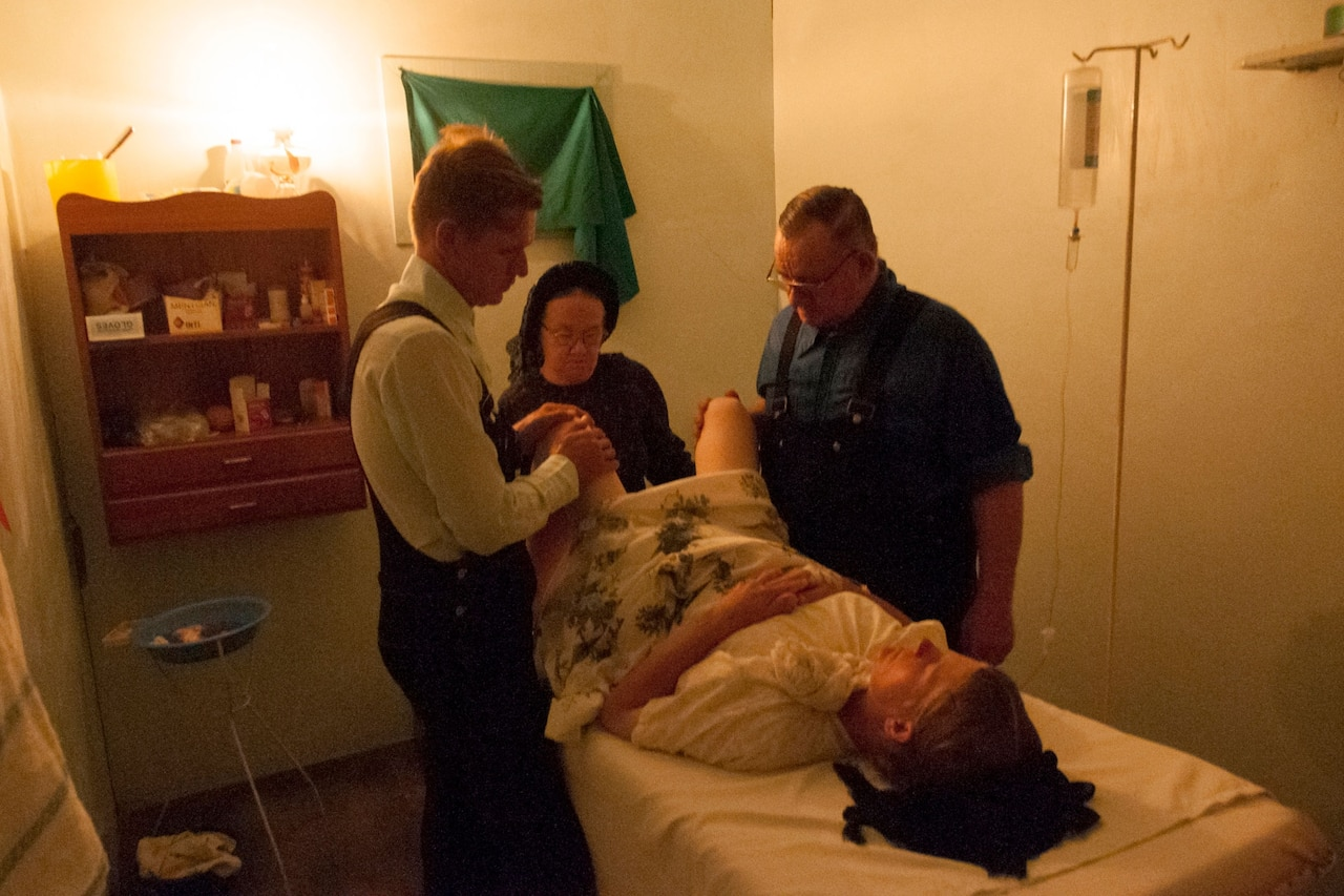 Elisabeth gives birth to her sixth son as her husband Frans looks on. The doctor and nurse are both self-taught. Nueva Esperanza Colony, Bolivia. 2008