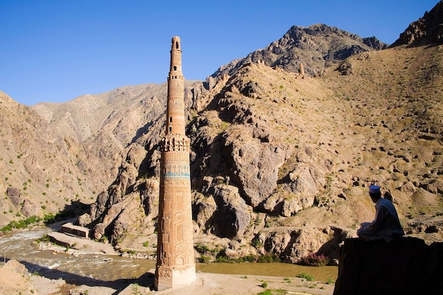 """<p>In a deep river valley in Ghur province, the 213-foot <a href=""""https://whc.unesco.org/en/list/211"""" target=""""_blank"""">Minaret of Jam</a> marks where the ancient city of Firuzkuh once stood. The 12th-century construction is covered in intricate brickwork, Kufic inscription, and turquoise tile, and represents the architecture and ornamentation of the Islamic period in Central Asia.</p> <p>In 2002, the Minaret of Jam was inscribed World Heritage in Danger to encourage the development and implementation of a long-term conservation policy, including setting up boundaries and increasing staff.</p>"""