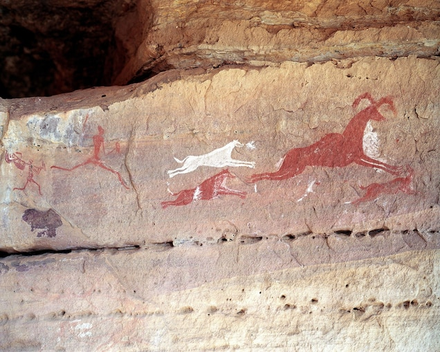 """<p>Near the Libya-Algeria border, thousands of cave paintings dating from 12,000 B.C. to 100 A.D. pepper the rocky massif of <a href=""""https://whc.unesco.org/en/list/287"""" target=""""_blank"""">Tadrart Acacus</a>, including depictions of giraffes, elephants, horses, and people.</p> <p>Amidst ongoing conflict in the region, the prehistoric cave art has been subjected to increasing vandalism. In 2016, all five of Libya's World Heritage sites were added to the Danger List.<br> </p>"""