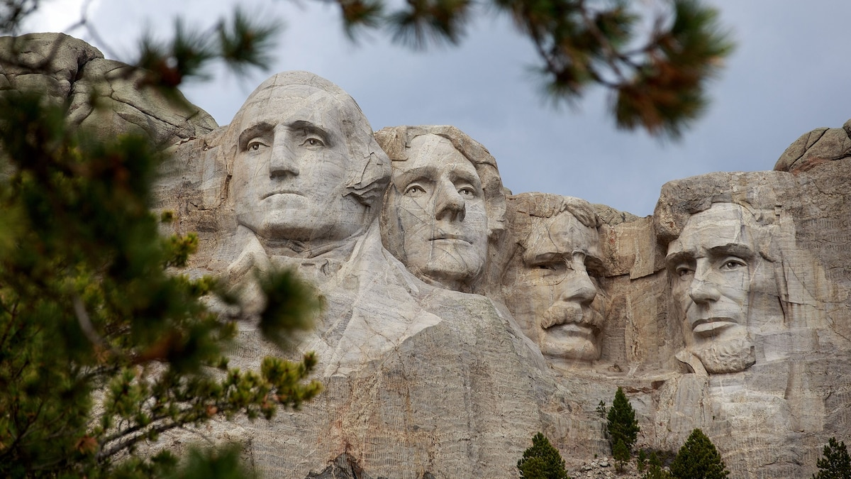 Tourists flock to South Dakota's massive presidential portraits. How they got there is a complex tale of land grabs, egos, and foiled movie scenes.