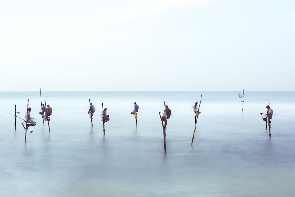 Stilt Fishermen Image | National Geographic Your Shot Photo of the Day