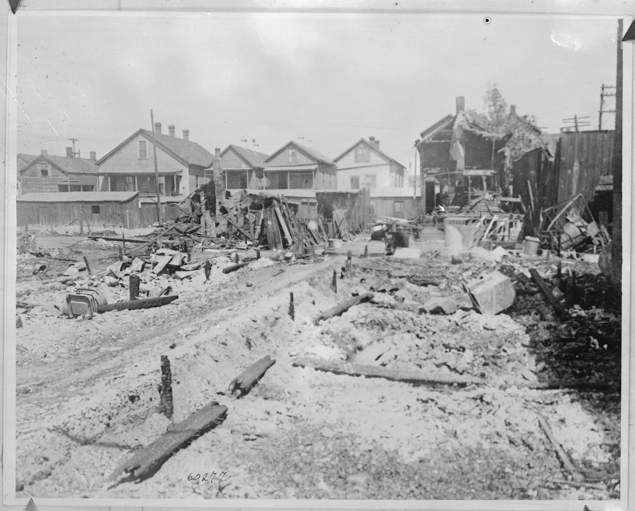 burned down houses with a few still standing in the background