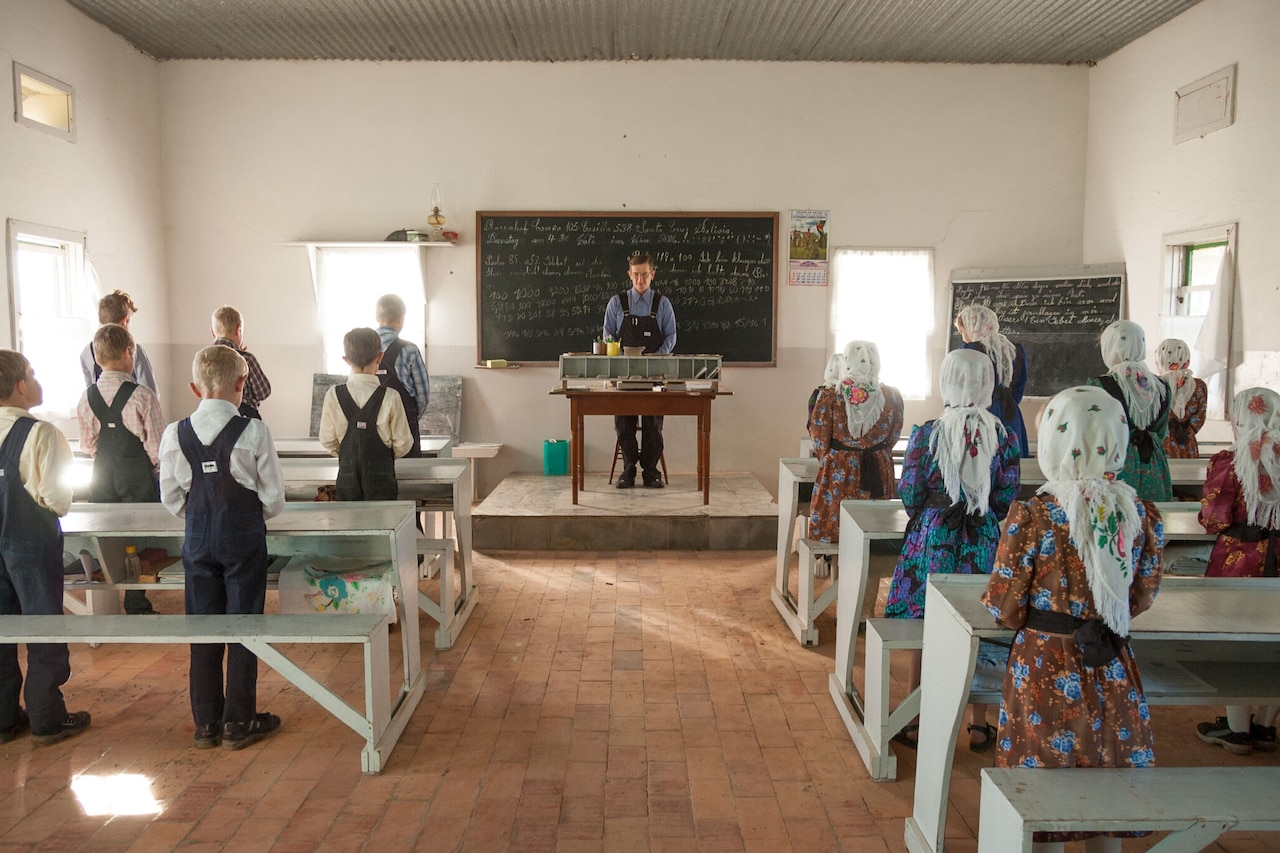 A prayer starts the day in Franz Petters' classroom. Children attend school from ages six to 13 years old. Girls sometimes leave a year earlier if they have begun menstruating unless their father agrees they can stay. The curriculum includes math, writing and reading in Low and High German, and religion. With the exception of one modern colony, Busqué says, they do not study science, history, or literature. Colonia Swift Current, Bolivia. 2006