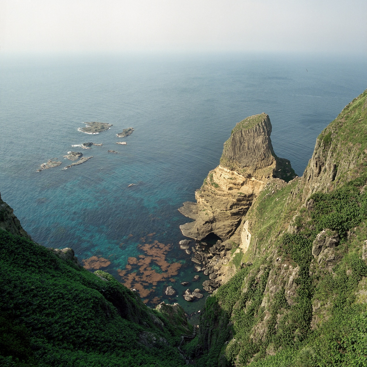 The west island is inhabitable because of the steep, vertical rocks.