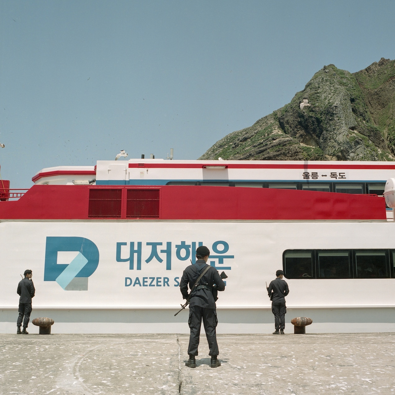 A tourist boat docks for a visit.
