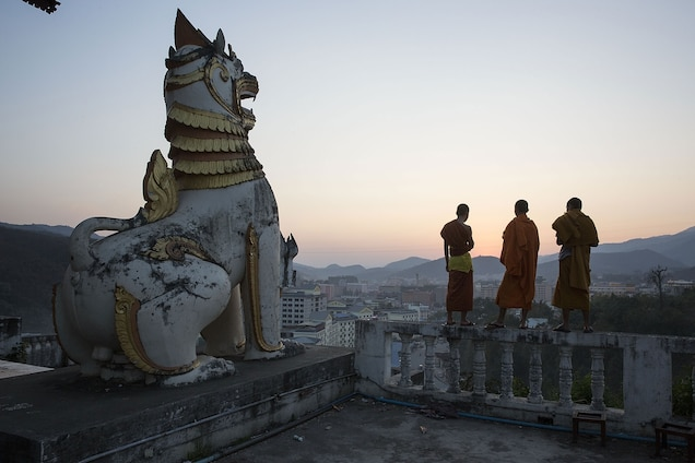 Monks overlook the city of Mong La, where many Chinese cross the border into Myanmar for gambling, prostitution, and illegal wildlife products. Photograph by Taylor Weidman, Getty Images