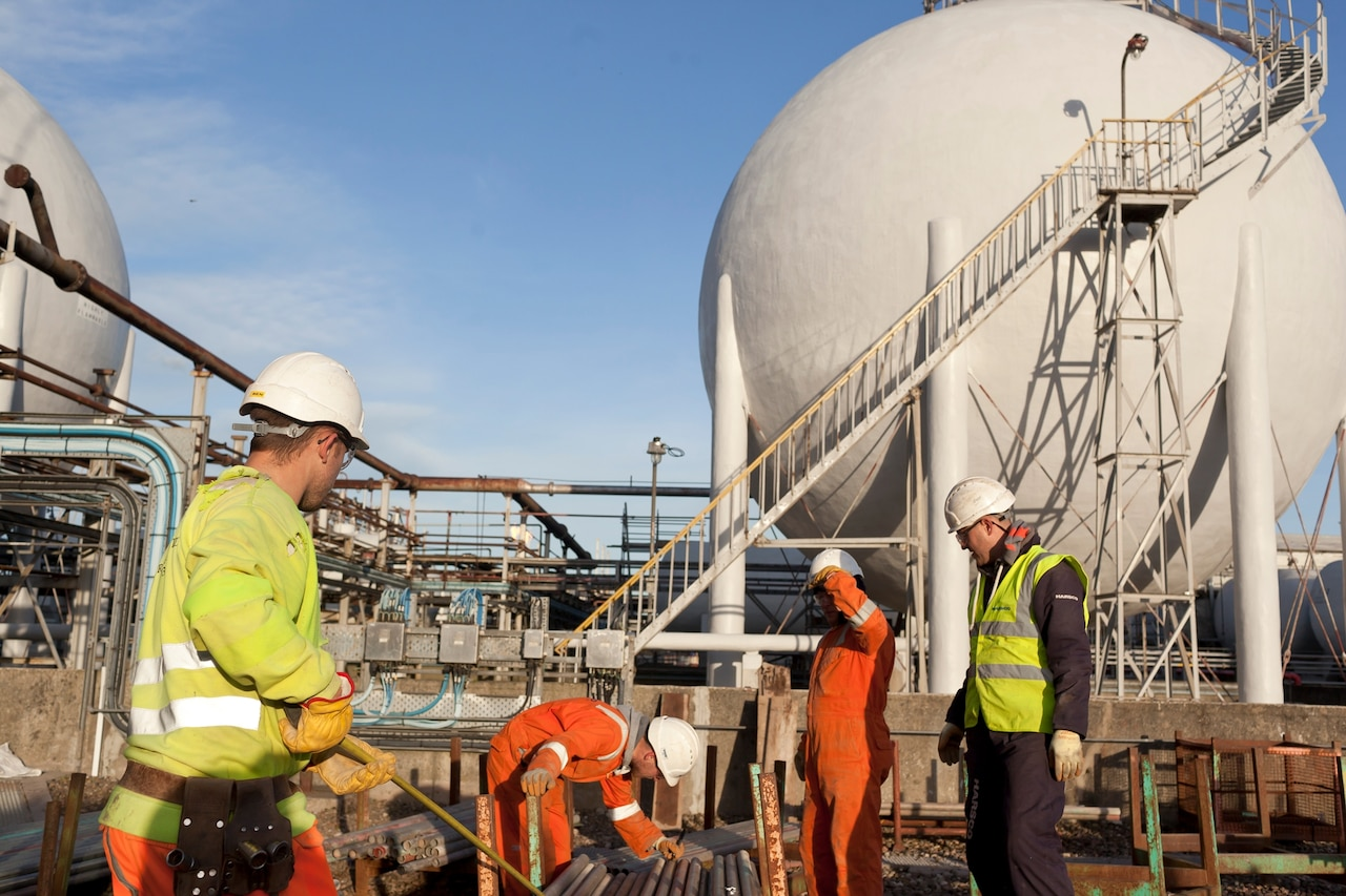 workers inspecting pipe at an ineos facility