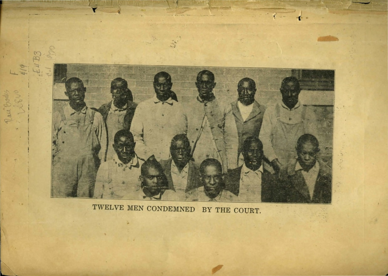 a page from a book showing a photograph of twelve black men lined up