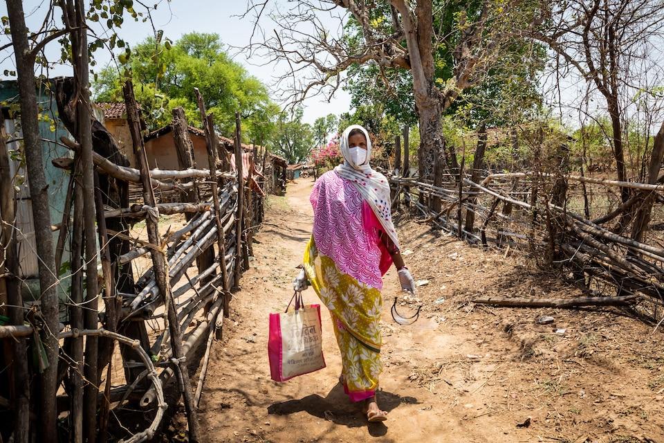 Health worker walks door-to-door in rural India.
